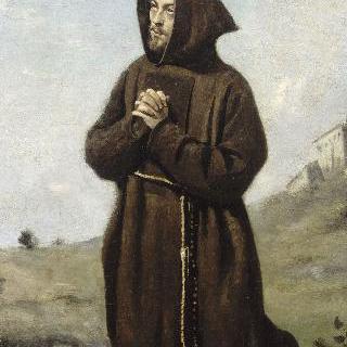 무릎 꿇고 기도하는 갈색옷을 입은 수도사