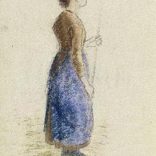 두 손으로 지팡이를 잡고 서있는 젊은 여인