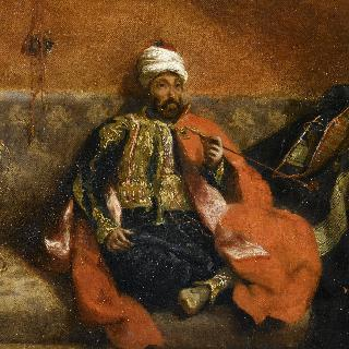 긴 의자에 앉아 담배를 피우는 터키 사람