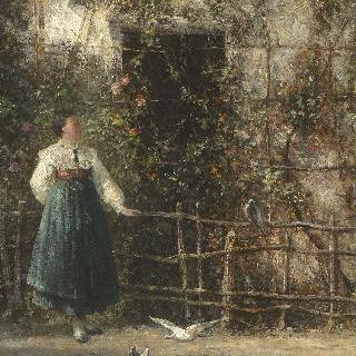 비둘기들에게 씨앗을 주는 여인