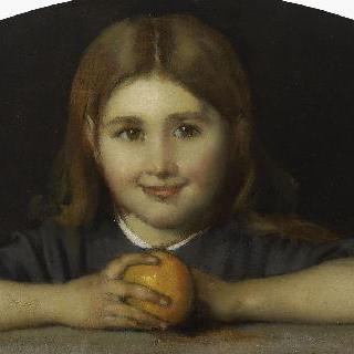 오렌지를 손에 들고 있는 어린 소녀