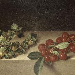 테이블 위에 까치밤나무 열매와 체리