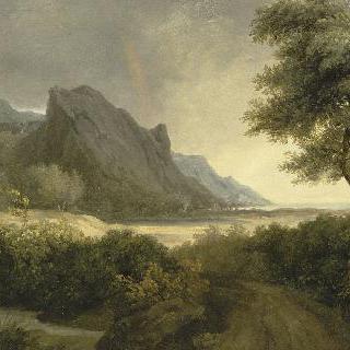 바다에 둘러싸인 산이 많은 풍경 ; 무지개