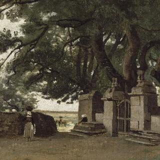 브르타뉴 지방의 농부. 큰 나무가 그림자를 드리운 철문