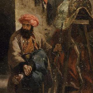 안장 앞에 앉은 터키 남자