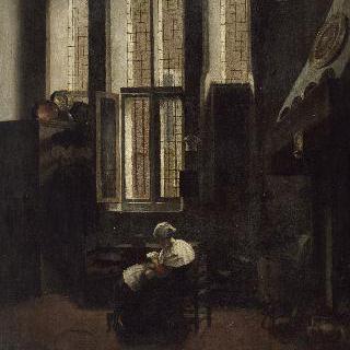 실내. 소년에게 책을 읽어주는 앉아있는 여인