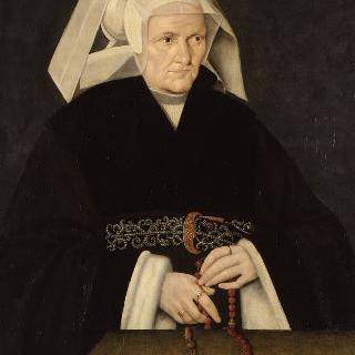 흰 색 모자를 쓰고 묵주신공하는 여인의 초상