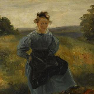 초원에 앉아있는 소녀