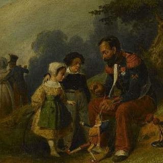 꼭두각시 인형의 끈을 당기며 두 아이와 놀아주는 공병