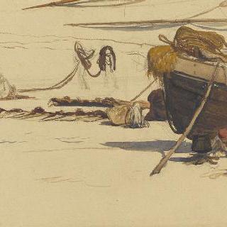 식사를 준비하는 모래 위에 좌초된 작은 배 부근의 어부