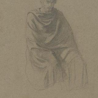 동맹 : 외투로 뒤덮은 앉아있는 남자