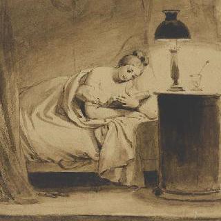침대에서 책을 읽고 있는 젊은 여자