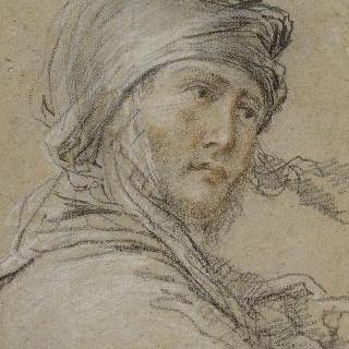 4분의 3 우측 방향의 터번을 두르고 철모를 쓴 남자의 초상