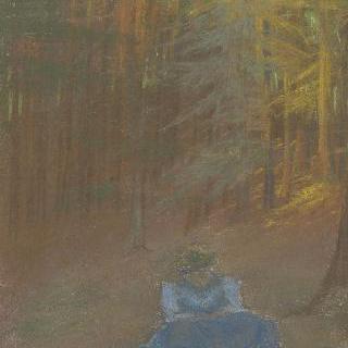 숲 속의 초목 아래서 웅크리고 있는 젊은 여자