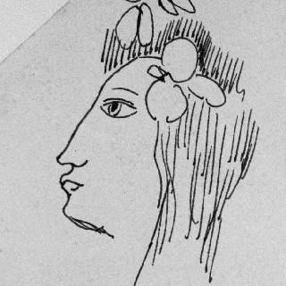 머리에 꽃을 꽂은 여인의 좌측 측면 두상