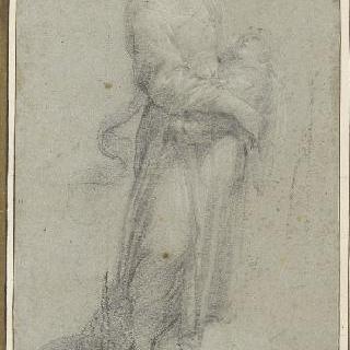 아이를 팔 안에 안고 서 있는 한 여인