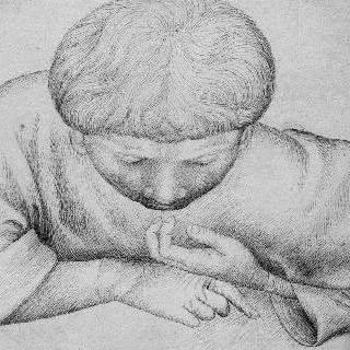 고개를 숙이고 팔꿈치를 괴고 있는 아이의 정면 상반신