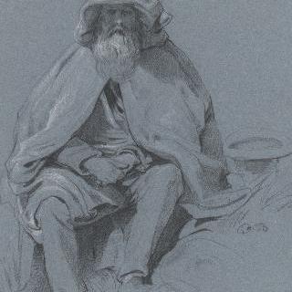 소매없는 만토를 입고 앉아 있는 노인