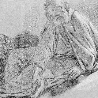 손에 모자를 들고 앉아서 구걸하는 수도사
