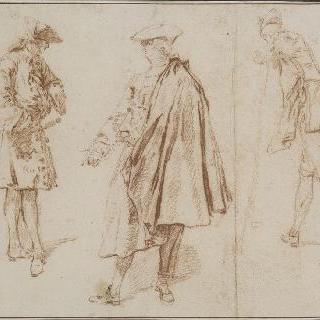 다른 포즈로 서 있는 세 남자들