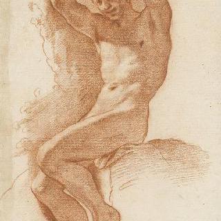 두 팔을 올리고 앉아있는 나체의 남자