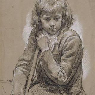 막대기에 기대어 앉아있는 어린 소년의 정면 초상