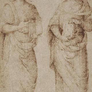 책을 들고 서 있는 주름진 천을 두른 두 남자