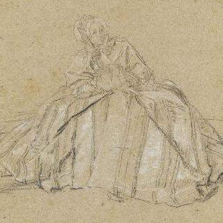 토시에 손을 넣고 줄무늬가 있는 커다란 옷을 입고 앉아있는 한 여인