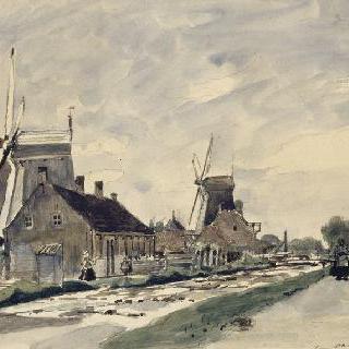 네덜란드의 운하를 따라 나 있는 집들과 풍차들