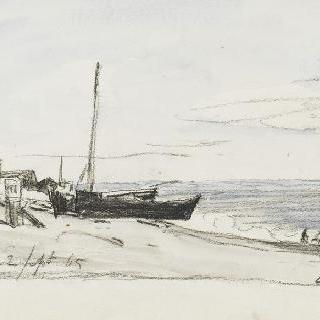 작은 배들이 좌초된 모래사장
