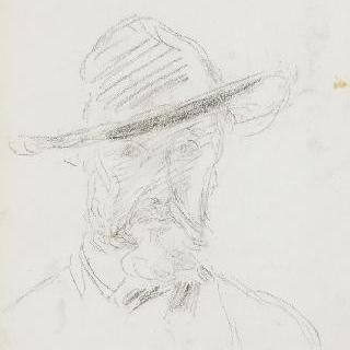커다란 모자를 쓴 남자의 정면 두상