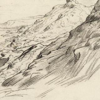 바닷가의 바위가 있는 언덕