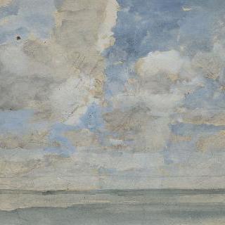 잔잔한 바다 위의 구름낀 하늘