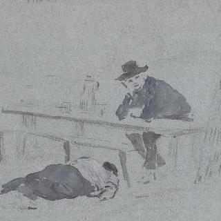 사람이 누워있는 탁자 앞에 팔꿈치를 기대고 앉아있는 남자 이미지