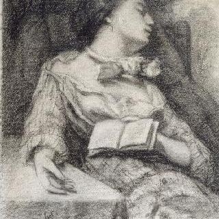 테이블 위에 오른손을 올려놓고, 책을 쥔채로, 앉아서 잠이 든 여자