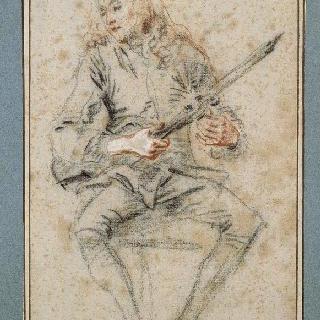 바이올린의 음조를 맞추는 젊은 음악가