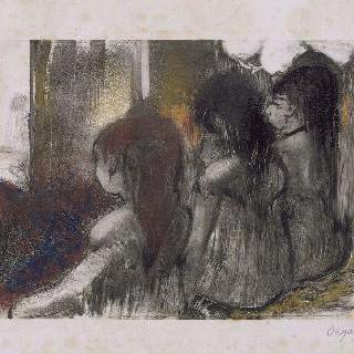 등을 보이고 앉아 있는 세 소녀