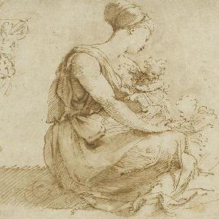 두 아이들과 바닥에 앉아있는 젊은 여인과 뒷모습의 남자
