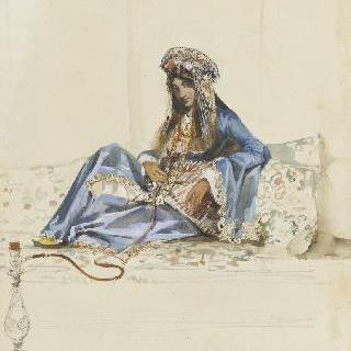 위자 위에 반쯤 누워 수연통을 피는 터키 여인