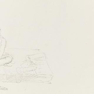 바닥에 놓여있는 매트리스 위에 앉아있는 남자