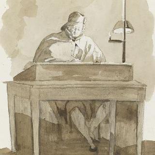 램프의 희미한 빛 아래서 일하는 탁자에 앉아있는 남자