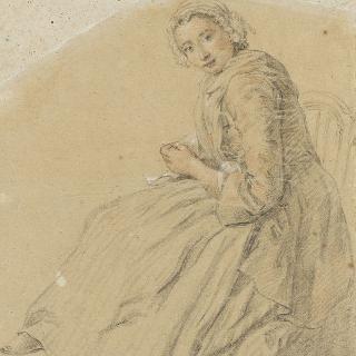 앉아있는 젊은 여인
