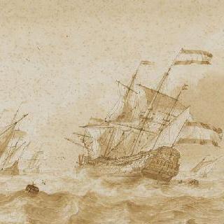 기복이 있는 바다 위의 소형보트와 대군함