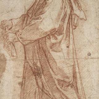 주름진 옷을 입고 서 있는 남자의 왼쪽 측면상