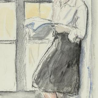 창문가에 서 있는 책 읽는 자야