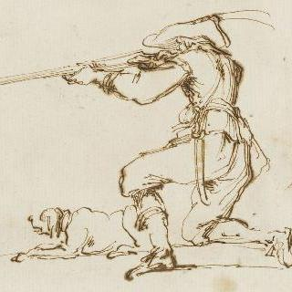 자신의 개와 함께 무릎을 꿇고 사냥총을 쏘는 남자