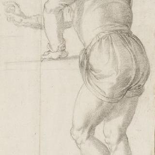 왼손을 기대고 있는 서 있는 남자의 뒷모습