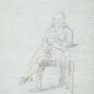 탁자 주변에 앉아서 편지를 읽는 남자