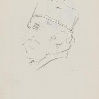 챙 없는 모자를 쓴 남자의 측면 초상