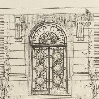 돌 주변 장식이 있는 철문